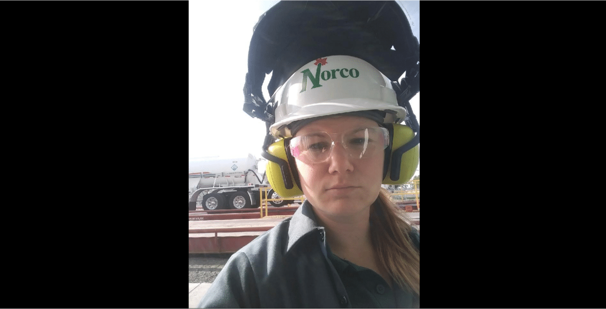 female with safety helmet and ear protection